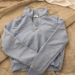light blue cropped half zip up